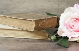 old books and flower rose on a wooden background romantic fl frame background picture of a flowers lying on an antique book