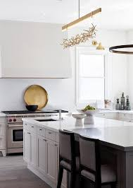 gold and gray kitchen with gold linear chandelier