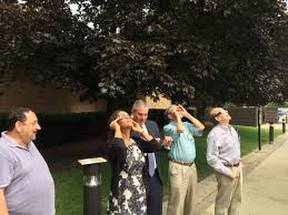 members of board viewing the eclipse l to r paul munk cynthia plouché jon levey neil dahlmann and len tenner