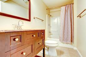 new bathroom addition with interior tile floor and vanity cabinet and shower