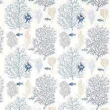 c fish fabric a printed and embroidered curtain fabric featuring blue and green fish swimming through c on a white background