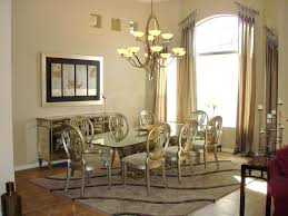 luxurious vicctorian style dining room with rectangle glass dining table and classic gold chairs plus mirrored console cabinet over antique hanging lamp