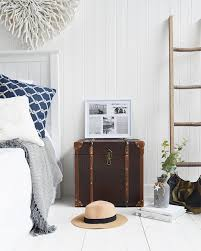 panama vintage style trunk as a bedside table in new england country and coastal homes and