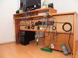 Great cable management. Using a pegboard and zip ties.