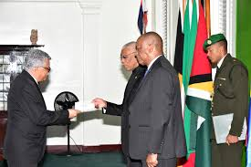 this ministry of the presidency photo shows dr alfonso munera cavadia left presenting his letters of credence to president david granger