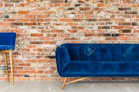 red brick furniture. Red Brick Wall, Blue Sofa And Chair Stock Photo - 70236690 Furniture