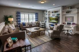 Example of a large classic living room design in Atlanta with gray walls  and a tv