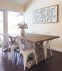 farmhouse dining room table dining room farmhouse farmhouse table with metal chairs from homespun signs i don t like the metal chairs