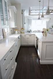kitchens with white cabinets and dark floors. Kitchen Peninsula With White Quartz Countertop And Dark Hardwood Flooring (the Back Of Kitchens Cabinets Floors