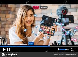 woman does makeup while recording live stream with video player interface stock photo