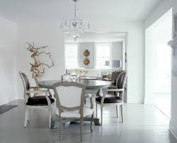 decorate your place by using white chandelier for dining room
