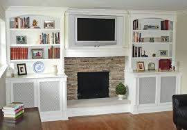 bookcase white built ins tv and fireplace mesh screen to hide electronics built in bookshelves