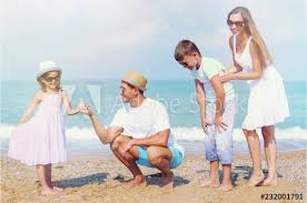 happy family on vacations on beach background