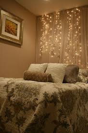 White Lights And Tulle Hung As A Backdrop Behind Your Bed
