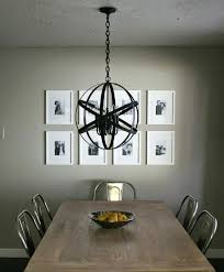elegant dining room with chrome chair and black metal orb chandelier oil rubbed bronze