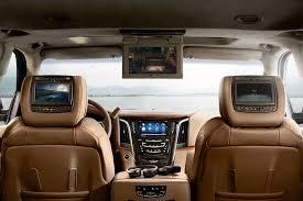 cadillac escalade 2015 platinum interior. the interior includes three tv screens total including one that drops from ceiling cadillac escalade 2015 platinum bloomberg