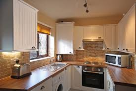 Kitchen:Design Small Kitchen With White Cabinets And The Sink And Added A  Gas Stove