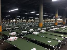 rows of cots from the american red cross set up in the kay bailey hutchinson convention center in downtown dallas a mega shelter will open for thousands