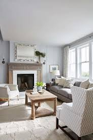 welcoming gray living room features a charcoal gray sofa accented with gray polka dot pillows and placed beneath windows covered by gray and white curtains