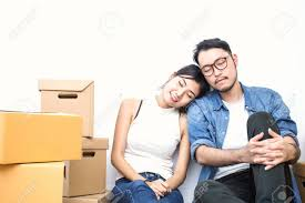 Start Boxes Asian Woman And Asian Man Resting And Sleeping Near Boxes Start