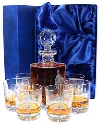a panel cut set of whisky crystal consisting of a decanter and six whisky tumblers