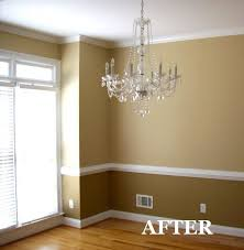 two tone dining room with chair rail light color above dark color below