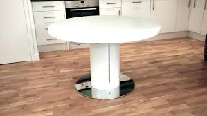 extendable round dining table light oak round dining table and chairs chair extending round dining table