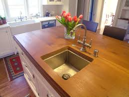 Kitchen island featuring a Teak wood countertop Nott Associates