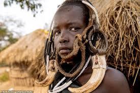 african tribe start wearing plates