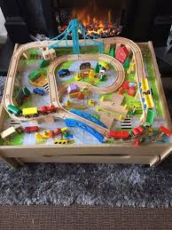 120 piece wooden train set reversible city table with storage drawer