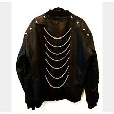 upcycled leather er jacket with pyramid stud details on shoulders backside cut outs with chain embellishing signature on sleeve