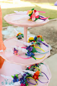 three tiered tray with numerous felt unicorn horn and flower headbands displayed