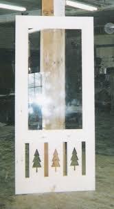 decorative storm door. custom wood storm door with decorative panels at the bottom. (