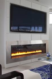 gas fireplace with tv on top