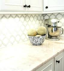 faux stone paint painting to look like soapstone white kitchen cabinet with countertops formica