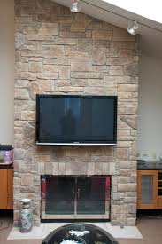 below are some images that show a few of our stone fireplaces with televisions mounted above stone fireplaces with flat screen tvs