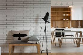 amusing white brick wall in living room design with dining table set beside  wooden cabinet kitchen