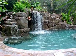 The Waterfall Swimming Pools Backyard And Hot Tubs