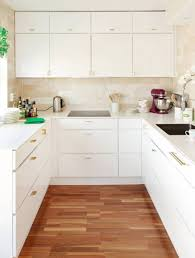Modern Kitchen Cabinets And Gold Brass Drawer Pulls In Small Mid