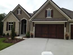like exterior colors wood garage door no visible hardware and wood shutters