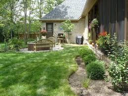Lawn & Garden:Corner Wooden Garden Bench Ideas With Stone Edging Also  Decorative Planters And