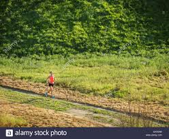 grass field from above. Woman Running In Field - Stock Image Grass From Above E