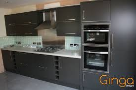 modern kitchen with glass tiles and graphite colour doors