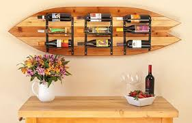 surfboard furniture. use your old vintage surfboard as a mount for new wine rack furniture