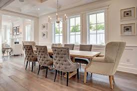long trestle dining table with gray velvet tufted dining chairs