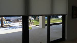motorized roller shades on sliding doors
