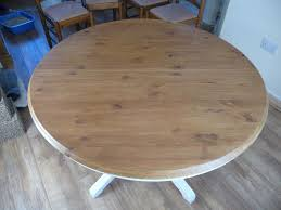 solid pine round extended dining table with 4 chairs in ipswich