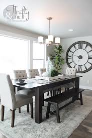 how to decorate with a large clock as decor in a dining room by thrifty and chic