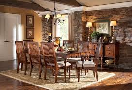 brown stained wooden dining chairs set with stick backrest and turned legs plus square white leather