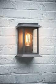 outdoor wall mounted porch light in charcoal the hing 1 front fixture ideas door placement modern